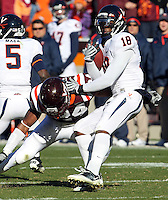 Nov 27, 2010; Charlottesville, VA, USA; Virginia Cavaliers wide receiver Kris Burd (18) is tackled by Virginia Tech Hokies linebacker Tariq Edwards (24) during the game at Lane Stadium. Virginia Tech won 37-7. Mandatory Credit: Andrew Shurtleff-