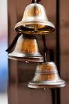 Small bells hanging on drugstore door knob.