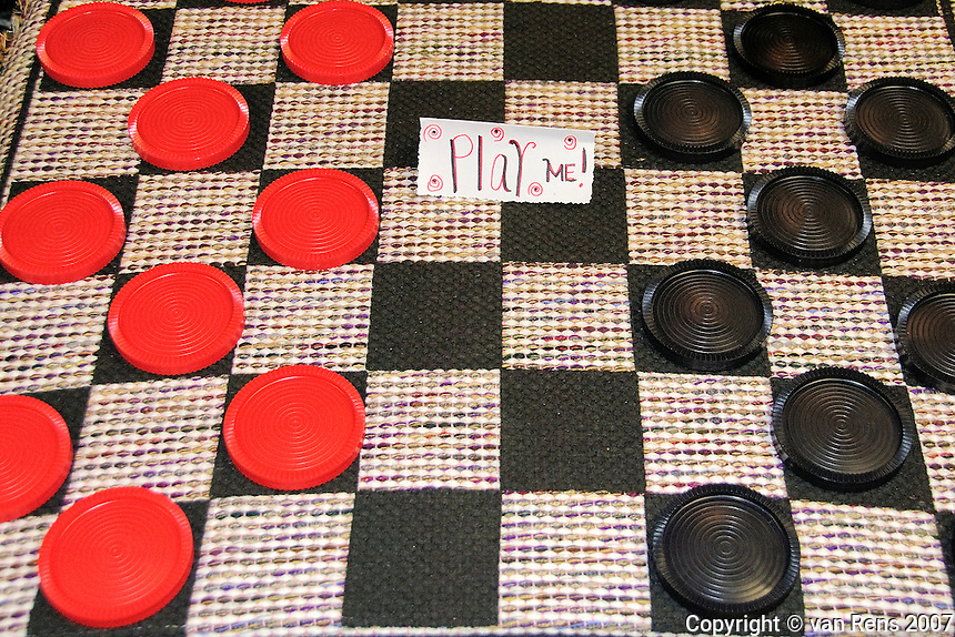 American  checkers on a fabric board awaits players.