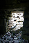 Clochan na Carraige, an early Christian stone beehive dwelling on Inishman, on the Aran Islands, Ireland.