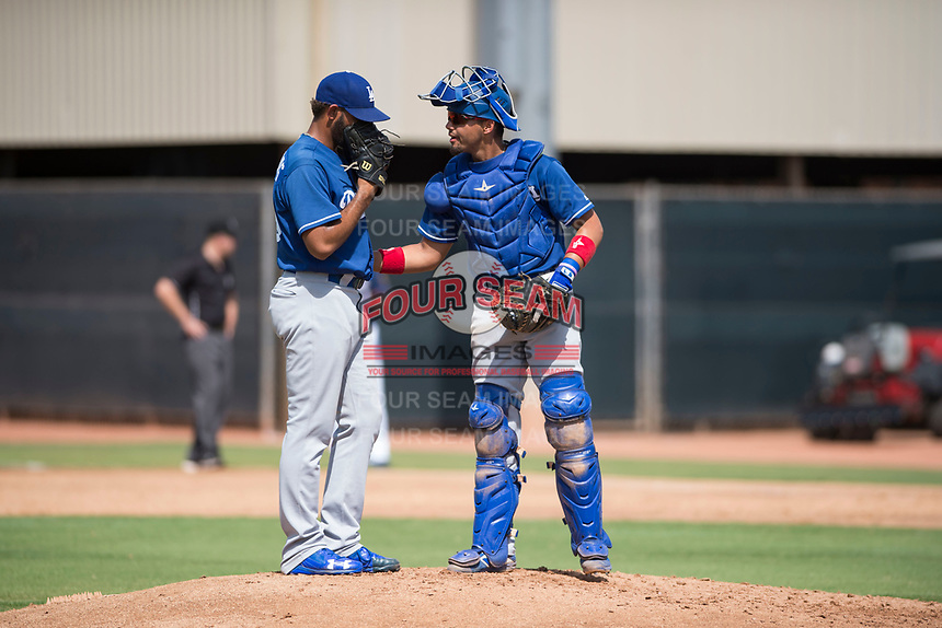 Los Angeles Dodgers catcher Ramon Rodriguez (55) talks to relief pitcher Nelfri Contreras (63) during an Instructional League game against the Milwaukee Brewers at Maryvale Baseball Park on September 24, 2018 in Phoenix, Arizona. (Zachary Lucy/Four Seam Images)
