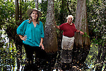 Anne and Jack Rudloe wade through a cypress swamp on their property in Panacea, Florida May 10, 2009  (Mark Wallheiser/TallahasseeStock.com)