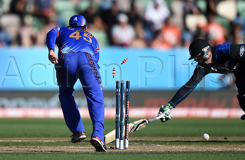 08.03.2015. Napier, New Zealand.  Martin Guptill is run out during the ICC Cricket World Cup match between New Zealand and Afghanistan at McLean Park in Napier, New Zealand. Sunday 8 March 2015.