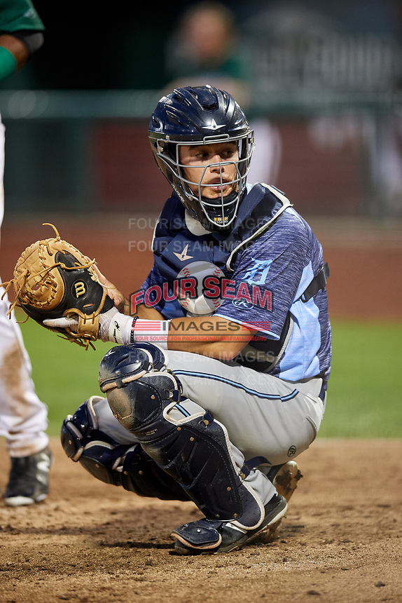 West Michigan Whitecaps catcher Brady Policelli (6) looks into the dugout during a game against the Fort Wayne TinCaps on May 17, 2018 at Parkview Field in Fort Wayne, Indiana.  Fort Wayne defeated West Michigan 7-3.  (Mike Janes/Four Seam Images)