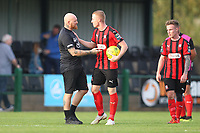 Paul Martin manager of Romford denies Sam Bantick the match ball at the final whistle during Romford vs Coggeshall Town, Bostik League Division 1 North Football at Rookery Hill on 13th October 2018