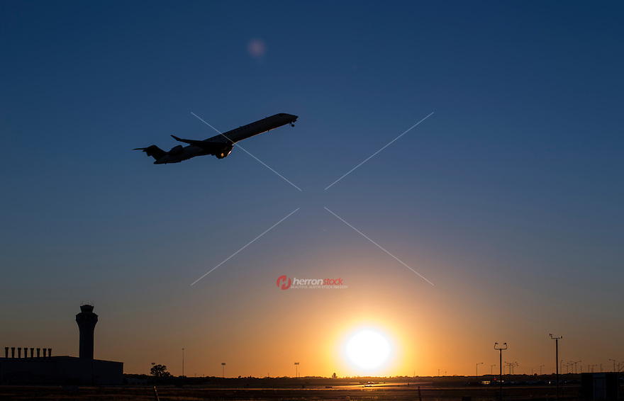 Jet Airline take-off at sunset from the Austin Airport, Austin, Texas.