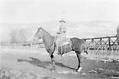 Lady on horseback.  Trestle to Chama coaling station in background.<br /> D&amp;RG  Chama, NM