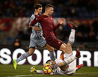 Calcio, ottavi di finale di Tim Cup: Roma vs Sampdoria. Roma, stadio Olimpico, 19 gennaio 2017.<br /> Sampdoria's goalkeeper Christian Puggioni, bottom, grabs the ball past his teammate Bartosz Bereszynski, left, and Roma&rsquo;s Edin Dzeko during the Italian Cup round of 16 football match between Roma and Sampdoria at Rome's Olympic stadium, 19 January 2017.<br /> UPDATE IMAGES PRESS/Isabella Bonotto