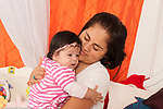 4 month old baby girl held by mother upset comforted