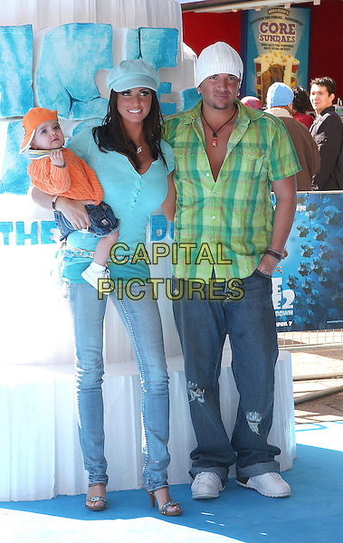 """KATIE PRICE (JORDAN), PETER ANDRE & SON JUNIOR.attending the Film Premiere of """"Ice Age 2: The Meltdown"""" Empire Leicester Square, London, England, .3rd April 2006..full length married husband wife family child baby caps hats green shirt blue turquoise orange clothes skinny jeans.Ref: BEL.www.capitalpictures.com.sales@capitalpictures.com.©Tom Belcher/Capital Pictures."""