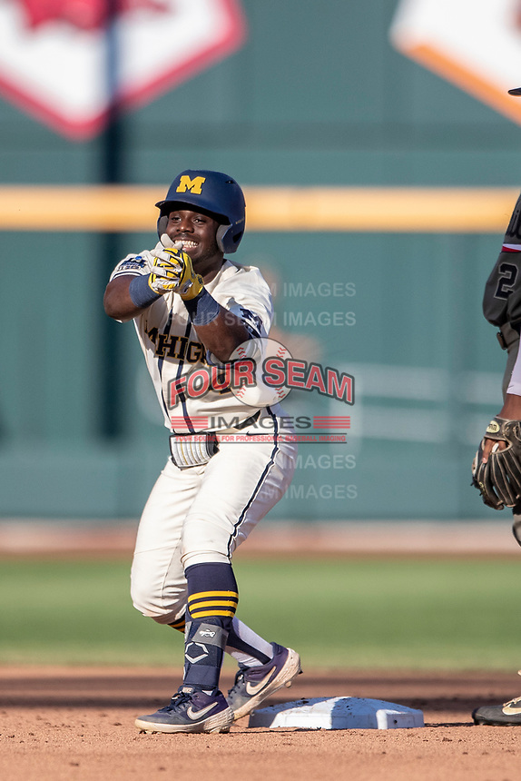 Michigan Wolverines second baseman Ako Thomas (4) celebrates hitting a double against the Vanderbilt Commodores during Game 1 of the NCAA College World Series Finals on June 24, 2019 at TD Ameritrade Park in Omaha, Nebraska. Michigan defeated Vanderbilt 7-4. (Andrew Woolley/Four Seam Images)