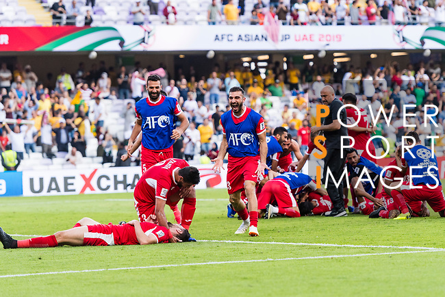 The Jordan team celebrates winning after the AFC Asian Cup UAE 2019 Group B match between Australia (AUS) and Jordan (JOR) at Hazza Bin Zayed Stadium on 06 January 2019 in Al Ain, United Arab Emirates. Photo by Marcio Rodrigo Machado / Power Sport Images