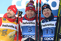 1st January 2020, Toblach, South Tyrol , Italy; Winner Alexander Bolshunov second placed Sergey Ustiugov of Russia and third placed Iivo Niskanen of Finland pose on podium after the mens cross country skiing 15 km classic style pursuit at the FIS Tour de Ski event in Toblach, Italy on January 1, 2020.