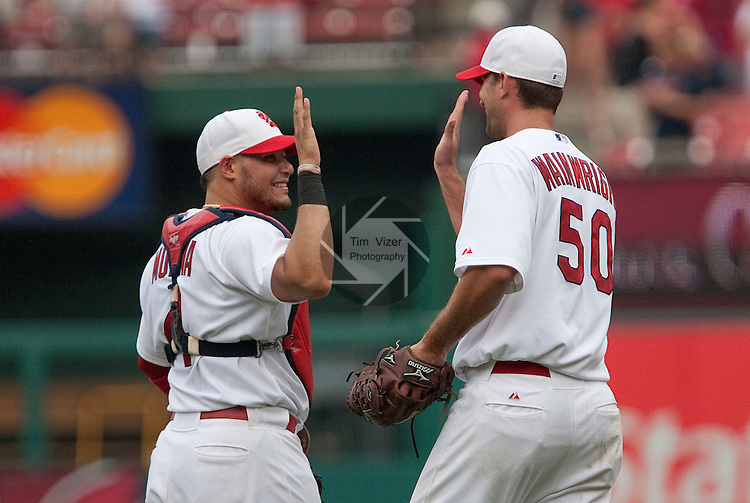 July 4, 2010          St. Louis Cardinals catcher Yadier Molina (4) and St. Louis Cardinals starting pitcher Adam Wainwright (50) congratulate each other after the St. Louis Cardinals defeated the Milwaukee Brewers 7-1 in the final game of a four-game homestand at Busch Stadium in downtown St. Louis, MO on Sunday July 4, 2010.