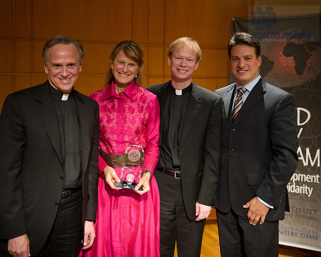 Oct. 31, 2013; Social entrepreneur Jacqueline Novogratz received the Kellogg Institute's 2013 Notre Dame Award for International Human Development and Solidarity as part of the Notre Dame Forum on women in leadership. She is photographed with University President Rev. John I. Jenkins, C.S.C., Rev. Bob Dowd, C.S.C., director of the Ford Family Program in Human Development, and Paolo Carozza, Director of the Kellogg Institute for International Studies.<br /> <br /> Photo by Matt Cashore/University of Notre Dame