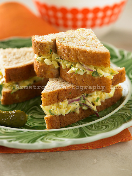 Curried egg whites on whole wheat bread, sliced into triangles.