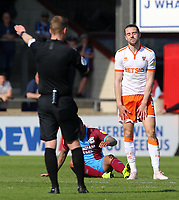 Referee Martin Coy pulls Blackpool's Antony Evans up for a foul<br /> <br /> Photographer David Shipman/CameraSport<br /> <br /> The EFL Sky Bet League One - Scunthorpe United v Blackpool - Friday 19th April 2019 - Glanford Park - Scunthorpe<br /> <br /> World Copyright © 2019 CameraSport. All rights reserved. 43 Linden Ave. Countesthorpe. Leicester. England. LE8 5PG - Tel: +44 (0) 116 277 4147 - admin@camerasport.com - www.camerasport.com