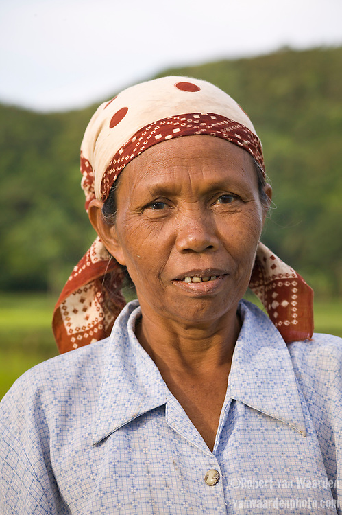 Portrait of an Indonesian woman made while planting rice in Lombok, Indonesia.