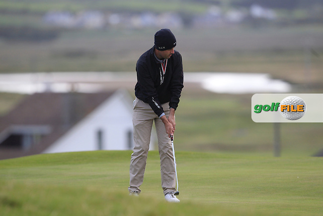 Liam Hutchinson (The Royal Dublin) on the 1st green during Round 2 of the South of Ireland Amateur Open Championship at LaHinch Golf Club on Thursday 23rd July 2015.<br /> Picture:  Golffile | Thos Caffrey