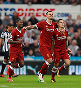 1st October 2017, St James Park, Newcastle upon Tyne, England; EPL Premier League football, Newcastle United versus Liverpool; Philippe Coutinho is hugged by Dejan Lovren after Coutinho made it 0-1 in the 29th minute with Georginio Wijnaldum of Liverpool close by