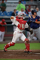 Auburn Doubledays catcher Andrew Pratt (33) throws down to second base as batter Ryan Kreidler (12) looks on during a NY-Penn League game against the Connecticut Tigers on July 12, 2019 at Falcon Park in Auburn, New York.  Auburn defeated Connecticut 7-5.  (Mike Janes/Four Seam Images)