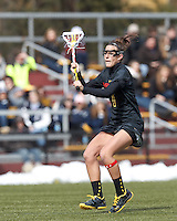 University of Maryland midfielder Katie Schwarzmann (7) passes the ball. .University of Maryland (black) defeated Boston College (white), 13-5, on the Newton Campus Lacrosse Field at Boston College, on March 16, 2013.