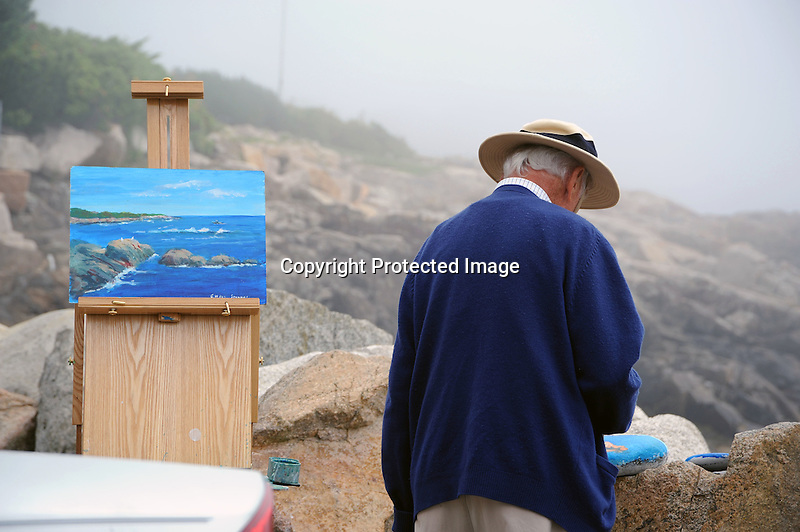 Artist at Work on the Shore in Maine, USA