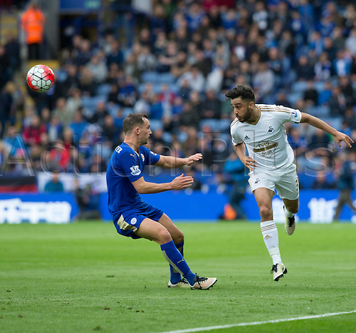 24.04.2016. King Power Stadium, Leicester, England. Barclays Premier League. Leicester versus Swansea.  Swansea City defender Neil Taylor heads the ball to clear it from Leicester City midfielder Danny Drinkwater.