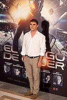 Producer poses during a photocall for the film Ender's Game in Madrid on October 3, 2013. (ALTERPHOTOS/Victor Blanco)