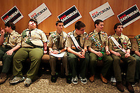 Boy Scouts wait to conduct the pledge of allegance during a rally for Republican presidential candidate Rick Santorum at New Life Assembly Church in Spokane Valley, Washington on March 1, 2012.