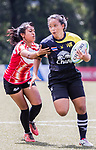 Chayathip Kuabphimai of Thailand is tackled by Diyana Khairunnisa Bte Muhammad Afiq Al-Matin of Singapore in a try during the Asia Rugby U20 Sevens 2017 at King's Park Sports Ground on August 5, 2017 in Hong Kong, China. Photo by Yu Chun Christopher Wong / Power Sport Images