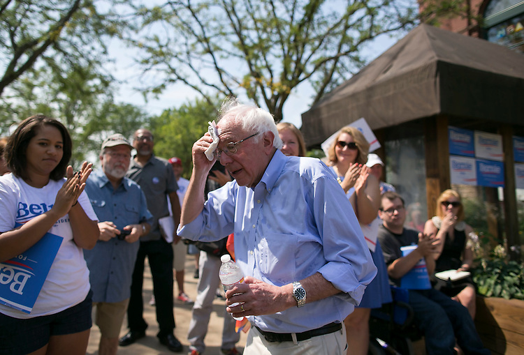 UNITED STATES - August 16: Sen. Bernie Sanders, D-Vt., wipes away sweat from his forehead after speaking at the Cedar Rapids Field Headquarters Opening in Marion, Iowa, on Sunday, August 16, 2015. (Photo By Al Drago/CQ Roll Call)