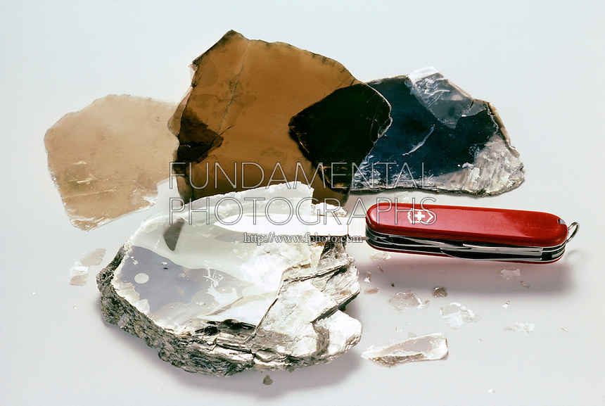 MUSCOVITE (MICA) CLEAVAGE<br /> KAl3Si3O10(OH)2 - A Disilicate (Phyllosilicate)<br /> Muscovite, or mica, is shown with three flakes extracted by splitting the mica parallel to its perfect cleavage.