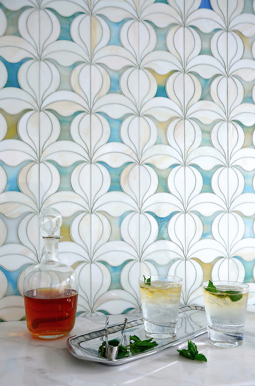 Calla, a jewel glass waterjet mosaic shown in Quartz and Aquamarine, is part of the Miraflores collection by Paul Schatz for New Ravenna.