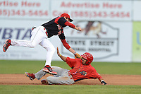 Batavia Muckdogs second baseman J.T. Riddle (5) tags out Gustavo Martinez (24) attempting to steal second during a game against the Williamsport Crosscutters on September 4, 2013 at Dwyer Stadium in Batavia, New York.  Williamsport defeated Batavia 6-3 in both teams season finale.  (Mike Janes/Four Seam Images)