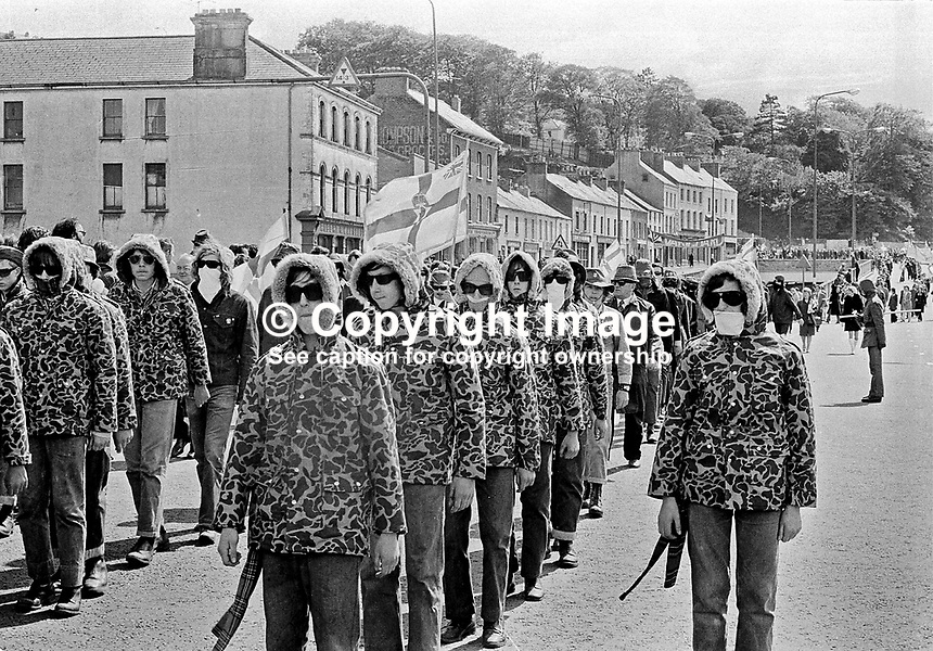 Ulster Defence Association members parade in Duke Street, Londonderry, N Ireland, UK. UDA. NI Troubles. Masked. March. Ref: 19720603001...Copyright Image from Victor Patterson, 54 Dorchester Park, Belfast, UK, BT9 6RJ..Tel: +44 28 9066 1296.Mob: +44 7802 353836.Voicemail +44 20 8816 7153.Skype: victorpattersonbelfast.Email: victorpatterson@mac.com.Email: victorpatterson@ireland.com (back-up)..IMPORTANT: If you wish to use this image or any other of my images please go to www.victorpatterson.com and click on the Terms & Conditions. Then contact me by email or phone with the reference number(s) of the image(s) concerned.