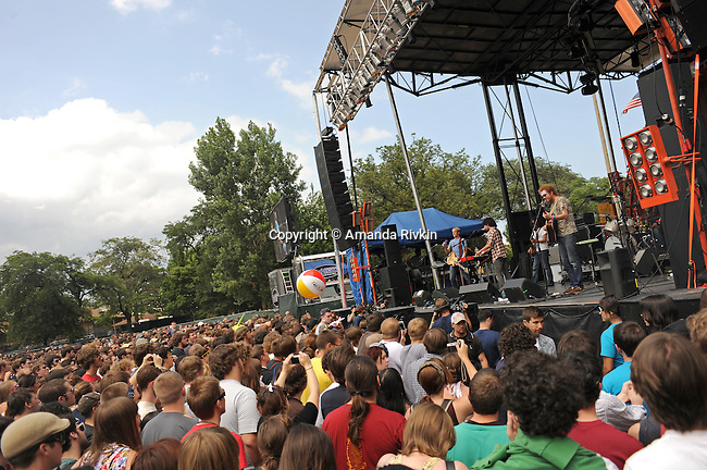 The audience passes a beach ball around as Blitzen Trapper plays the main stage at Pitchfork Music Festival in Union Park in Chicago, Illinois on July 19, 2009.