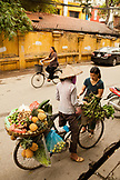 VIETNAM, Hanoi, a street vendor sells pineapples, limes and other produce from her bicycle