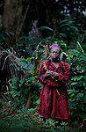 A woman carrying firewood across the jungle in Cameroon