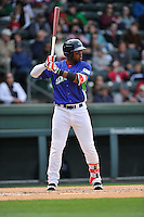 Left fielder Kyri Washington (21) of the Greenville Drive bats in a game against the Asheville Tourists on Sunday, April 10, 2016, at Fluor Field at the West End in Greenville, South Carolina. Greenville won 7-4. (Tom Priddy/Four Seam Images)
