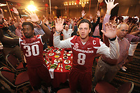 NWA Democrat-Gazette/ANDY SHUPE<br /> Team captains Kevin Richardson II (from left), Arkansas defensive back, and quarterback Austin Allen call the Hogs Friday, Aug. 18, 2017, alongside a room full of fans during the Kickoff Luncheon at the Northwest Arkansas Convention Center in Springdale. Visit nwadg.com/photos to see more photographs from the luncheon.
