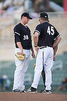 Kannapolis Intimidators pitching coach Brian Drahman (45) has a meeting on the mound with starting pitcher Brannon Easterling (38) during the game against the Hickory Crawdads at Kannapolis Intimidators Stadium on June 11, 2016 in Kannapolis, North Carolina.  The Crawdads defeated the Intimidators 7-5.  (Brian Westerholt/Four Seam Images)