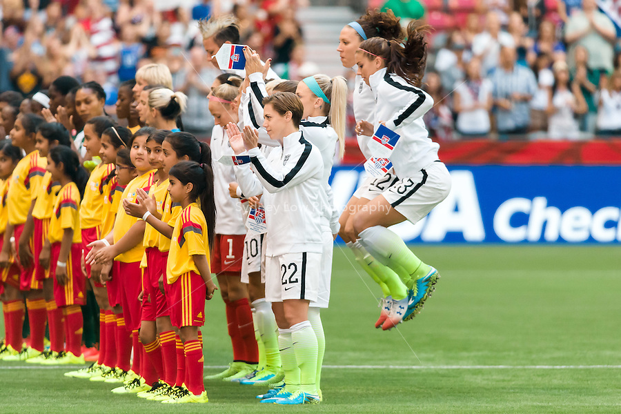 June 16, 2015: The USA team finishes singing the national anthem prior to a Group D match at the FIFA Women's World Cup Canada 2015 between Nigeria and the USA at BC Place Stadium on 16 June 2015 in Vancouver, Canada. Sydney Low/Asteriskimages.com