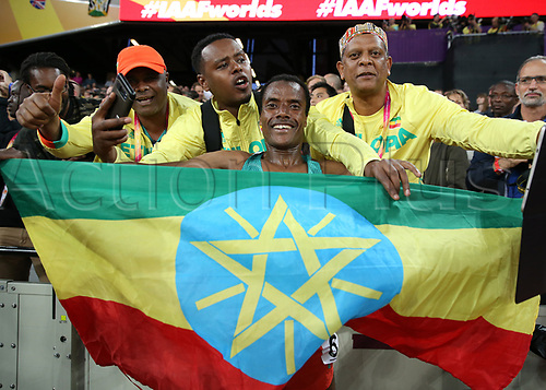 August 12th 2017, London Stadium, East London, England; IAAF World Championships, Day 9; Muktar Edris of Ethiopia celebrates with the flag of Ehiopia with fans after finishing 1st place to become World Champion of the 5000 metres men final