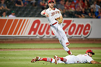 Memphis Redbirds third baseman Patrick Wisdom (5) throws to first base during a game against the Round Rock Express on April 28, 2017 at AutoZone Park in Memphis, Tennessee.  Memphis defeated Round Rock 9-1.  (Mike Janes/Four Seam Images)