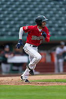 Fort Wayne TinCaps third baseman Tucupita Marcano (15) runs to first base during a Midwest League game against the Fort Wayne TinCaps at Parkview Field on April 30, 2019 in Fort Wayne, Indiana. Kane County defeated Fort Wayne 7-4. (Zachary Lucy/Four Seam Images)