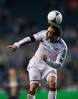 A.J. Soares (5) of the New England Revolution heads the ball away during the game at PPL Park in Chester, PA.  The Philadelphia Union defeated the New England Revolution, 1-0.