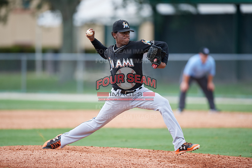 GCL Marlins relief pitcher Edgar Martinez (14) delivers a pitch during a game against the GCL Astros on July 22, 2017 at Roger Dean Stadium Complex in Jupiter, Florida.  GCL Astros defeated the GCL Marlins 5-1, the game was called in the seventh inning due to rain.  (Mike Janes/Four Seam Images)
