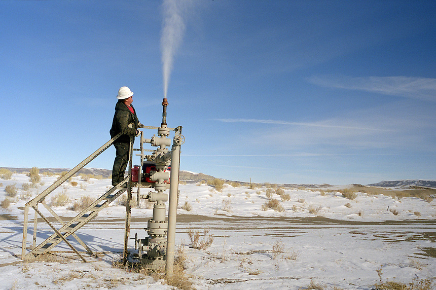 Oil worker Shane Heavin releases a burst of gas while maintaining a well among sand dunes in the Jack Morrow Hills north of Rock Springs, Wyoming. The area is under consideration for more gas drilling by the Bush administration after years of preservation.