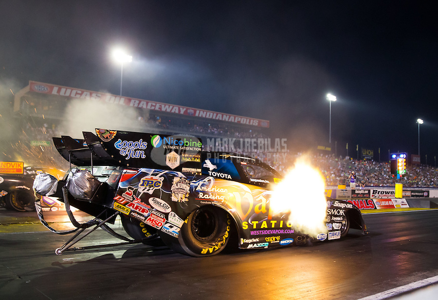 Sep 5, 2015; Clermont, IN, USA; NHRA funny car driver Tony Pedregon during qualifying for the US Nationals at Lucas Oil Raceway. Mandatory Credit: Mark J. Rebilas-USA TODAY Sports
